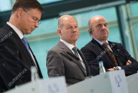 Valdis Dombrovskis (L), Executive Vice President of the European Commission, Olaf Scholz (C), German Finance Minister, and Luis de Guindos (R), Vice President of the European Central Bank, speak to the media at the conclusion of an informal meeting of European Union ministers for economic and financial affairs at the InterContinental Hotel Berlin, in Berlin, Germany, 12 September 2020. The meeting runs from 11 to 12 September.