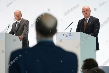 German Finance Minister Olaf Scholz (L) and Luis de Guindos (R), Vice President of the European Central Bank,isten to a reporter's question while speaking to the media at the conclusion ofthe Informal Meeting of European Union (EU) Ministers for Economic and Financial Affairs at the InterContinental Hotel Berlin, in Berlin, Germany, 12 September 2020. The meeting runs from 11 to 12 September.