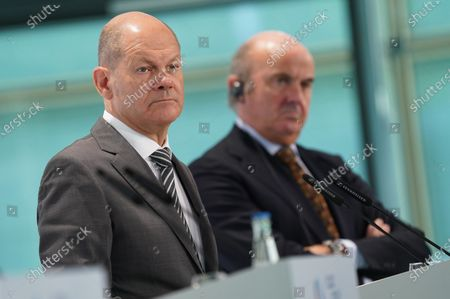 Olaf Scholz (L), German Finance Minister, and Luis de Guindos (R), Vice President of the European Central Bank, listen to a reporter's question while speaking to the media at the conclusion of an informal meeting of European Union ministers for economic and financial affairs at the InterContinental Hotel Berlin, in Berlin, Germany, 12 September 2020. The meeting runs from 11 to 12 September.