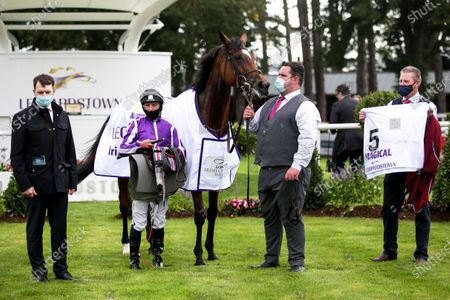 Stock Photo of The Irish Champion Stakes (Group 1). Ryan Lee Moore with trainer Aidan O'Brien and winning connections