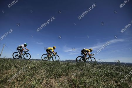 Austrian rider Lukas Postlberger (L) of the Bora-Hansgrohe team, Slovenian rider Primoz Roglic (C) and Dutch rider Tom Dumoulin (R), both of Team Jumbo-Visma, in action during the fourteenth stage of the Tour de France cycling race over 194km from Clermont-Ferrand to Lyon, France, 12 September 2020.