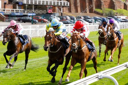 Harmony Lil and Hayley Turner [left] just beats Sir Benedict in the GoRacingGreen EBF Novice Stakes at Chester.