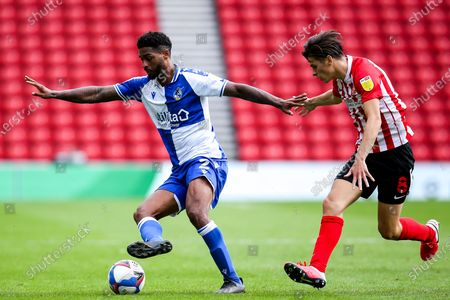 Mark Little of Bristol Rovers takes on George Dobson of Sunderland