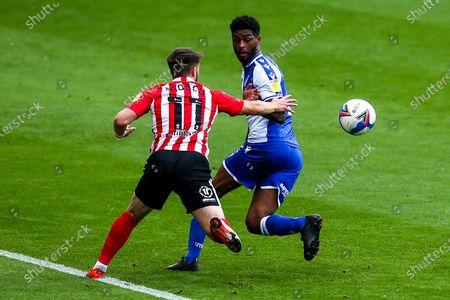 Mark Little of Bristol Rovers tackles Lynden Gooch of Sunderland