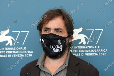 Director Stefano Mordini wears a mask due to the Covid-19 virus