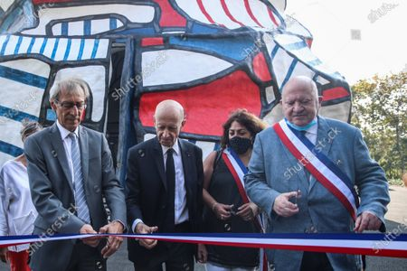 Stock Photo of Georges Siffredi, (L) president of the Hauts-de-Seine department, with Francois Guibault (C) president of the Dubuffet Foundation, and Andre Santini (R), mayor of Issy les Moulineaux, cut a ribbon during the inauguration of the restored Face Tower in Issy-les-Moulineaux, near Paris, France, 12 September 2020. The Face Tower built between 1986 and 1988 by French sculptor Jean Dubuffet in the Parc de l'Ile Saint-Germain marks the entrance to the valley of Hauts-de-Seine culture.