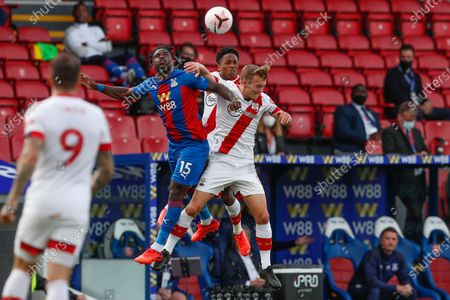 Crystal Palace's Jeffrey Schlupp and Southampton's James Ward-Prowse, right, jump for the ball during the English Premier League soccer match between Crystal Palace and Southampton, at Selhurst Park, London