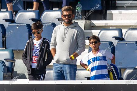 Stock Photo of Queens Park Rangers chairman Amit Bhatia with his two sons during the EFL Sky Bet Championship match between Queens Park Rangers and Nottingham Forest at the Kiyan Prince Foundation Stadium, London