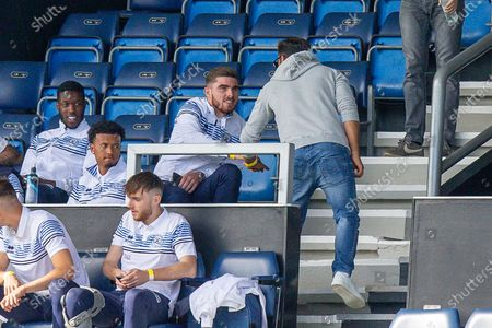 Queens Park Rangers forward Ryan Manning (14) appears on good terms with Queens Park Rangers chairman Amit Bhatia, despite being in the stands and amidst transfer speculation, during the EFL Sky Bet Championship match between Queens Park Rangers and Nottingham Forest at the Kiyan Prince Foundation Stadium, London