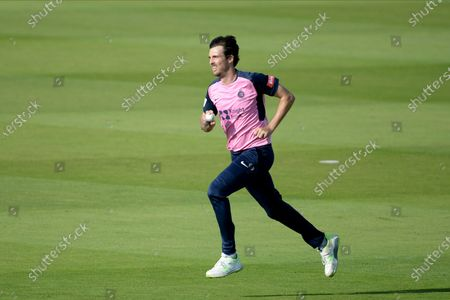 Steven Finn of Middlesex running in to bowl