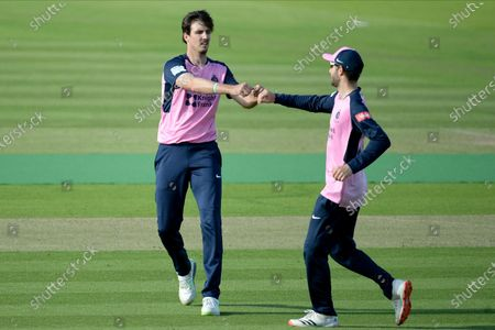 Steven Finn and Stephen Eskinazi of Middlesex celebrate the wicket of Lewis McManus
