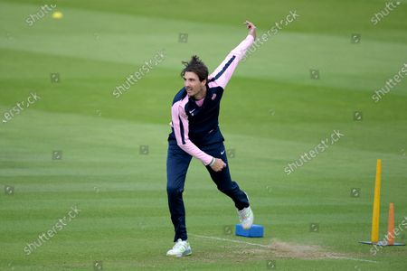 Steven Finn of Middlesex warming up