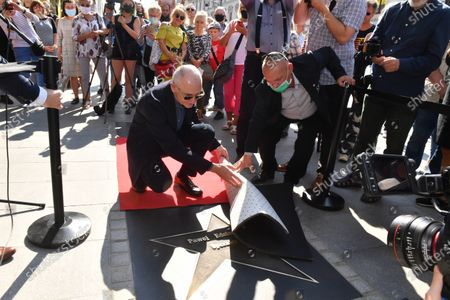 Polish cinematographer Pawel Edelman (L) attends the unveiling of his star on the Walk of Fame on Piotrkowska Street in Lodz, Poland, 12 September 2020. Pawel Edelman is known for his collaborations with compatriot directors Roman Polanski and Andrzej Wajda. He was named Best European Cinematographer in 2002 at the European Film Awards for his work on the film 'The Pianist', for which he also won the Cesar Award for Best Cinematography.