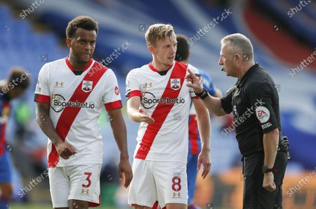 Referee Jon Moss talks to Southampton's Ryan Bertrand (L) and James Ward-Prowse during the English Premier League match between Crystal Palace and Southampton in London, Britain, 12 September 2020.