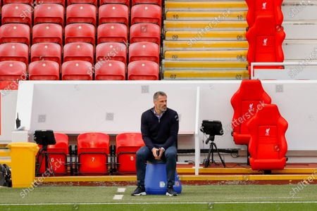 Jamie Carragher sits on Leeds United Manager Marcelo Bielsa seat during the Premier League match between Liverpool and Leeds United at Anfield, Liverpool