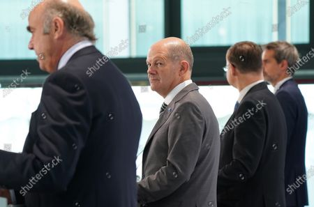 Valdis Dombrovskis (2nd from R), Executive Vice President of the European Commission, Olaf Scholz (C), German Finance Minister, and Luis De Guindos Jurado (L), Vice President of the European Central Bank, speak to the media at the conclusion of an informal meeting of European Union ministers for economic and financial affairs. The meeting took place under the current German presidency of the European Council.