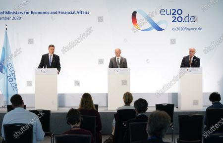 Stock Photo of Valdis Dombrovskis (L), Executive Vice President of the European Commission, Olaf Scholz (C), German Finance Minister, and Luis De Guindos Jurado (R), Vice President of the European Central Bank, speak to the media at the conclusion of an informal meeting of European Union ministers for economic and financial affairs. The meeting took place under the current German presidency of the European Council.