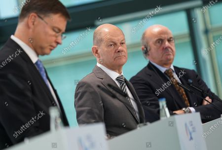 Stock Picture of Valdis Dombrovskis (L), Executive Vice President of the European Commission, Olaf Scholz (C), German Finance Minister, and Luis De Guindos Jurado (R), Vice President of the European Central Bank, speak to the media at the conclusion of an informal meeting of European Union ministers for economic and financial affairs. The meeting took place under the current German presidency of the European Council.