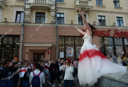 A Belarus woman in a wedding dress colored in white-red-white colour protest against the presidential election results during women's peaceful solidarity action in Minsk, Belarus, 12 September 2020. Opposition activists continue their every day protest actions, demanding new elections under international observation.