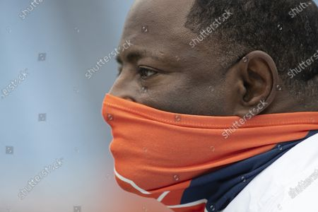 Syracuse head coach Dino Babers watches his team warm up for their NCAA college football game against North Carolina on in Chapel Hill, N.C