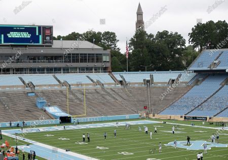 The North Carolina Tar Heels warm up for an NCAA college football game against Syracuse on inside empty Kenan Stadium in Chapel Hill, N.C. Fans have been prohibited from attending the game due to the COVID-19 virus