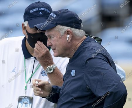 North Carolina head coach Mack Brown confers with Ken Browning before an NCAA college football game against Syracuse on in Chapel Hill, N.C