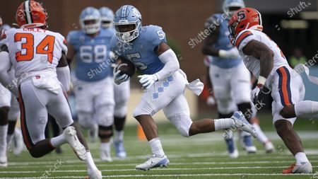 North Carolina's Dazz Newsome (5) looks for running room against the Syracuse defense in the first quarter of an NCAA college football game in Chapel Hill, N.C