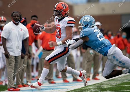 North Carolina linebacker Chazz Surratt (21) forces Syracuse quarterback Tommy DeVito (13) out of bounds in the second quarter of an NCAA college football game in Chapel Hill, N.C