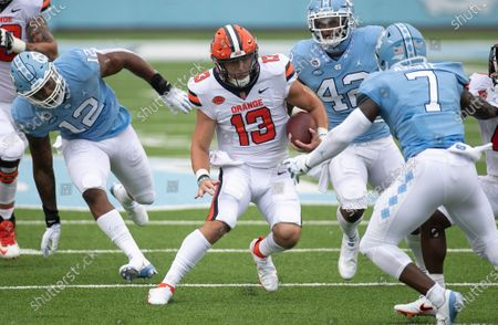 Syracuse quarterback Tommy DeVito (13) looks for running room against North Carolina's Eugene Asanti (7) during the second quarter of an NCAA college football game in Chapel Hill, N.C