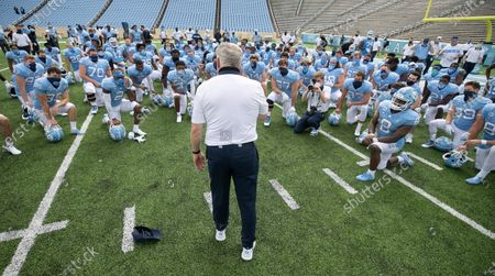 North Carolina coach Mack Brown meets with his team following their victory over Syracuse in an NCAA college football game, in Chapel Hill, N.C