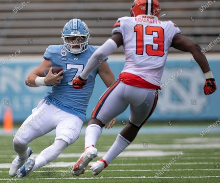North Carolina quarterback Sam Howell (7) slides under Syracuse's Mikel Jones (13) after a short gain in the fourth quarter of an NCAA college football game, in Chapel Hill, N.C