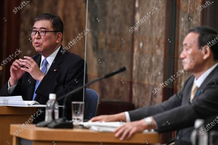 Japan's Liberal Democratic Party's leadership election candidates, former Japan's defence minister Shigeru Ishiba (left) and Japan's Chief Cabinet Secretary Yoshihide Suga (right) attend a debate ahead of the Liberal Democratic Party's (LDP) leadership election