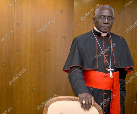 "Stock Photo of Cardinal Robert Sarah, prefect of the Congregation for Divine Worship and the Discipline of the Sacraments, arrives for the presentation of his book Divine Love Made Flesh, in Rome, . The Vatican said Saturday it was ""necessary and urgent"" to return to in-person Masses as soon as coronavirus lockdowns permit"