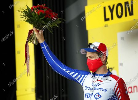 Stock Photo of Swiss rider Stefan Kueng of the Groupama FDJ team celebrates on the podium after being awarded the most combative rider following the 14th stage of the Tour de France cycling race over 194km from Clermont-Ferrand to Lyon, France, 12 September 2020.