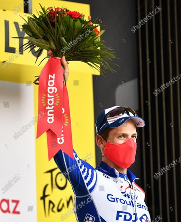 Swiss rider Stefan Kueng of the Groupama FDJ team celebrates on the podium after being awarded the most combative rider following the 14th stage of the Tour de France cycling race over 194km from Clermont-Ferrand to Lyon, France, 12 September 2020.