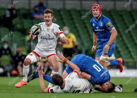 Leinster vs Ulster. Ulster's Iain Henderson offloads to Billy Burns as he is tackled by Ross Byrne of Leinster