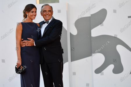 Alberto Barbera with his wife arrive for the awarding ceremony of the 77th annual Venice International Film Festival, in Venice, Italy, 12 September 2020. The event is the first major in-person film fest to be held in the wake of the Covid-19 coronavirus pandemic. Attendees had to follow strict safety measures like mandatory face masks indoors, temperature scanners, and socially distanced screenings to reduce the risk of infection. The public was barred from the red carpet, and big stars were largely absent this year. The 77th edition of the festival runs from 02 to 12 September 2020.