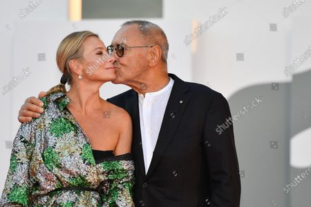 Andrei Konchalovsky with his wife arrive for the awarding ceremony of the 77th annual Venice International Film Festival, in Venice, Italy, 12 September 2020. The event is the first major in-person film fest to be held in the wake of the Covid-19 coronavirus pandemic. Attendees had to follow strict safety measures like mandatory face masks indoors, temperature scanners, and socially distanced screenings to reduce the risk of infection. The public was barred from the red carpet, and big stars were largely absent this year. The 77th edition of the festival runs from 02 to 12 September 2020.