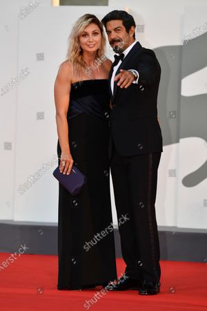 Pierfrancesco Favino with his wife Anna Ferzetti arrive for the awarding ceremony of the 77th annual Venice International Film Festival, in Venice, Italy, 12 September 2020. The event is the first major in-person film fest to be held in the wake of the Covid-19 coronavirus pandemic. Attendees had to follow strict safety measures like mandatory face masks indoors, temperature scanners, and socially distanced screenings to reduce the risk of infection. The public was barred from the red carpet, and big stars were largely absent this year. The 77th edition of the festival runs from 02 to 12 September 2020.