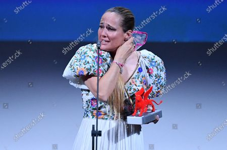 """Ana Rocha de Sousa acknowledges receiving the Lion of the Future - """"Luigi De Laurentiis"""" Venice Award for a Debut Film for """"Listen"""" during the closing ceremony on the last day of the 77th Venice Film Festival, in Venice, Italy, 12 September 2020. The event is the first major in-person film fest to be held in the wake of the Covid-19 coronavirus pandemic. Attendees had to follow strict safety measures like mandatory face masks indoors, temperature scanners, and socially distanced screenings to reduce the risk of infection. The public was barred from the red carpet, and big stars were largely absent this year. The 77th edition of the festival runs from 02 to 12 September 2020."""