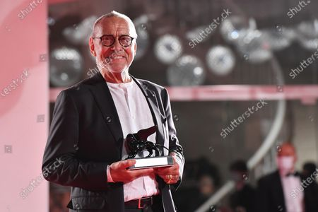 """Andrei Konchalovsky poses with the Special Jury Prize he received for """"Dear Comrades !"""" during the Winners' Photocall on the last day of the 77th Venice Film Festival, in Venice, Italy, 12 September 2020. The event is the first major in-person film fest to be held in the wake of the Covid-19 coronavirus pandemic. Attendees had to follow strict safety measures like mandatory face masks indoors, temperature scanners, and socially distanced screenings to reduce the risk of infection. The public was barred from the red carpet, and big stars were largely absent this year. The 77th edition of the festival runs from 02 to 12 September 2020."""