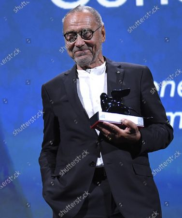 """Stock Photo of Andrei Konchalovsky poses with the Special Jury Prize he received for """"Dear Comrades !"""" during the Winners' Photocall on the last day of the 77th Venice Film Festival, in Venice, Italy, 12 September 2020. The event is the first major in-person film fest to be held in the wake of the Covid-19 coronavirus pandemic. Attendees had to follow strict safety measures like mandatory face masks indoors, temperature scanners, and socially distanced screenings to reduce the risk of infection. The public was barred from the red carpet, and big stars were largely absent this year. The 77th edition of the festival runs from 02 to 12 September 2020."""