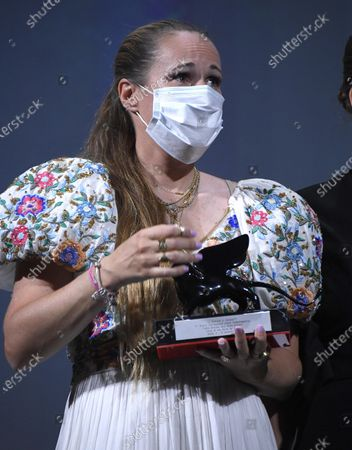 Ana Rocha de Sousa poses with the Lion of the Future - 'Luigi De Laurentiis' Venice Award for a Debut Film during the Winners' Photocall on the last day of the 77th Venice Film Festival, in Venice, Italy, 12 September 2020. The event is the first major in-person film fest to be held in the wake of the Covid-19 coronavirus pandemic. Attendees had to follow strict safety measures like mandatory face masks indoors, temperature scanners, and socially distanced screenings to reduce the risk of infection. The public was barred from the red carpet, and big stars were largely absent this year. The 77th edition of the festival runs from 02 to 12 September 2020.