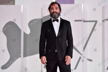 Stefano Mordini arrives for the premiere of 'Lasciami andare' (You Came Back) during the 77th annual Venice International Film Festival, in Venice, Italy, 12 September 2020. The event is the first major in-person film fest to be held in the wake of the Covid-19 coronavirus pandemic. Attendees had to follow strict safety measures like mandatory face masks indoors, temperature scanners, and socially distanced screenings to reduce the risk of infection. The public was barred from the red carpet, and big stars were largely absent this year. The 77th edition of the festival runs from 02 to 12 September 2020.
