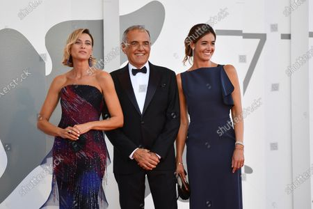 Anna Foglietta with Film Festival Director Alberto Barbera and his wife arrives for the awarding ceremony of the 77th annual Venice International Film Festival, in Venice, Italy, 12 September 2020. The event is the first major in-person film fest to be held in the wake of the Covid-19 coronavirus pandemic. Attendees had to follow strict safety measures like mandatory face masks indoors, temperature scanners, and socially distanced screenings to reduce the risk of infection. The public was barred from the red carpet, and big stars were largely absent this year. The 77th edition of the festival runs from 02 to 12 September 2020.
