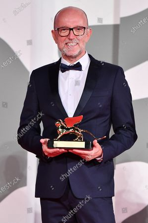 "Disney's Marketing Director for Italy, Davide Romani acknowledges receiving the Golden Lion for Best Film on behalf of US director Chloe Zhao for ""Nomadland"" during the closing ceremony on the last day of the 77th Venice Film Festival, in Venice, Italy, 12 September 2020. The event is the first major in-person film fest to be held in the wake of the Covid-19 coronavirus pandemic. Attendees had to follow strict safety measures like mandatory face masks indoors, temperature scanners, and socially distanced screenings to reduce the risk of infection. The public was barred from the red carpet, and big stars were largely absent this year. The 77th edition of the festival runs from 02 to 12 September 2020."