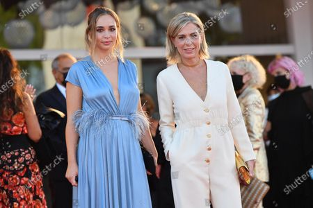 Francesca Comencini and her daughter Camille arrive for the awarding ceremony of the 77th annual Venice International Film Festival, in Venice, Italy, 12 September 2020. The event is the first major in-person film fest to be held in the wake of the Covid-19 coronavirus pandemic. Attendees had to follow strict safety measures like mandatory face masks indoors, temperature scanners, and socially distanced screenings to reduce the risk of infection. The public was barred from the red carpet, and big stars were largely absent this year. The 77th edition of the festival runs from 02 to 12 September 2020.