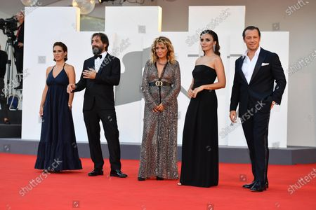 Valeria Golino (C), Maya Sansa (L), Italian filmmaker Stefano Mordini, Italian actors Serena Rossi and Stefano Accorsi (R) arrive for the awarding ceremony of the 77th annual Venice International Film Festival, in Venice, Italy, 12 September 2020.  The event is the first major in-person film fest to be held in the wake of the Covid-19 coronavirus pandemic. Attendees had to follow strict safety measures like mandatory face masks indoors, temperature scanners, and socially distanced screenings to reduce the risk of infection. The public was barred from the red carpet, and big stars were largely absent this year. The 77th edition of the festival runs from 02 to 12 September 2020.