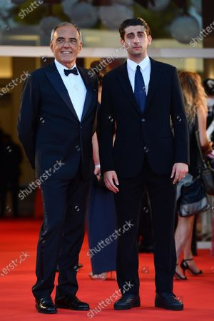 Italian filmaker Pietro Castellitto with Film Festival Director Alberto Barbera (R) arrive for the awarding ceremony of the 77th annual Venice International Film Festival, in Venice, Italy, 12 September 2020. The event is the first major in-person film fest to be held in the wake of the Covid-19 coronavirus pandemic. Attendees had to follow strict safety measures like mandatory face masks indoors, temperature scanners, and socially distanced screenings to reduce the risk of infection. The public was barred from the red carpet, and big stars were largely absent this year. The 77th edition of the festival runs from 02 to 12 September 2020.