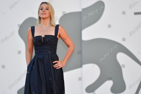 Ludivine Sagnier arrives for the awarding ceremony of the 77th annual Venice International Film Festival, in Venice, Italy, 12 September 2020. The event is the first major in-person film fest to be held in the wake of the Covid-19 coronavirus pandemic. Attendees had to follow strict safety measures like mandatory face masks indoors, temperature scanners, and socially distanced screenings to reduce the risk of infection. The public was barred from the red carpet, and big stars were largely absent this year. The 77th edition of the festival runs from 02 to 12 September 2020.
